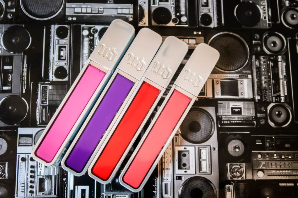 Lip Glosses On Top of a Cassette Player Pattern
