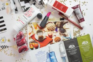 Beauty Products on top of a magazine