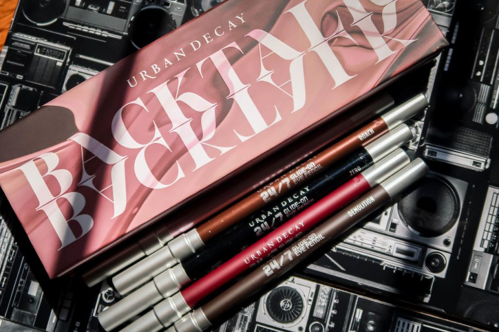 Urban Decay Backtalk Eye & Cheek Palette with Eyeliners on top of a Cassette Background