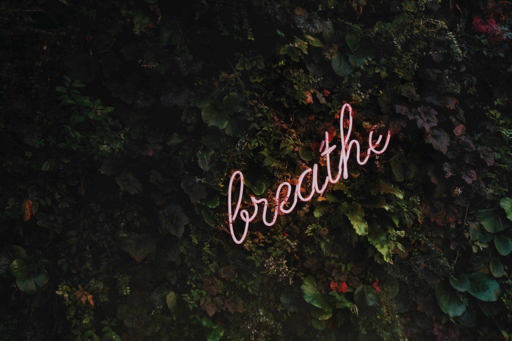 Coronavirus and Self Care. Just breathe neon sign