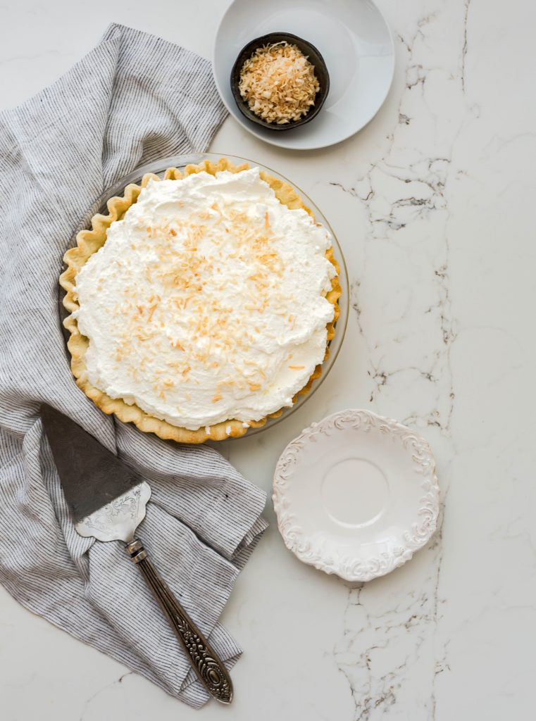 Pie and serving dish on table for Thanksgiving